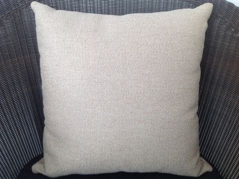Visit our website and see why this beige cushion is the hero of the day and not at all boring.
