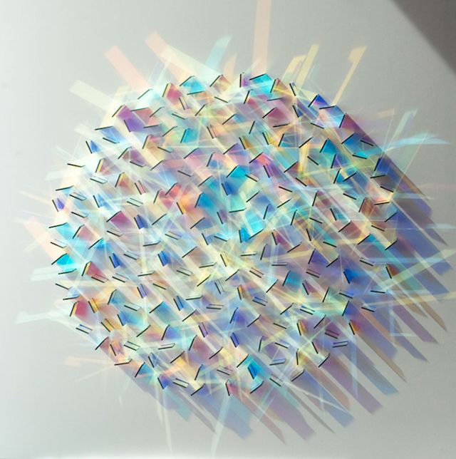 English artist Christine Wood uses little squares in #glass to create very beautiful circular #artworks where the light reflects different #colorful patterns on the wall.