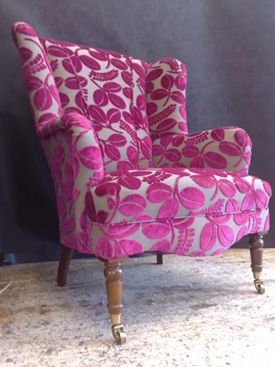 Wing Chair: 	  A high-backed armchair with side pieces projecting from the back, originally in order to protect the sitter from drafts.  My definition: A chair typically seen in living rooms and bedrooms that have distinct characteristics including a solid back and angled sides and seating for one.