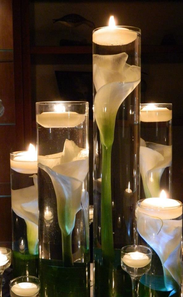 Magnific Idea !!! Submerged Calla Lilly Centerpieces: I could also show you a couple of pieces with water pearls that might be a good idea. This is simple and elegant.
