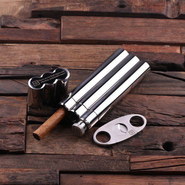 "Details: Handy stainless steel cigar holder with whiskey flask and cutters. Also available with wood gift box. Size: Stainless Steel 7″ X 2.5″, Cutters 3.5″ x 1.5"" FREE Personalization: limit 1 letter"