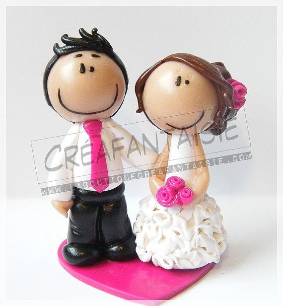 """Tiny wedding cake topper """"Natalia"""". This totally looks like me and Adrian. Haha!"""