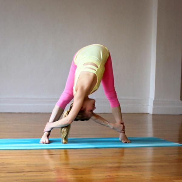 Yoga Poses: Wide-Legged Forward Fold with Shoulder Opener