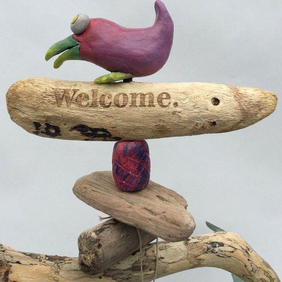 Meet Dottie-Ceramic Bird  sculpture on driftwood by LooneyCreationsShop
