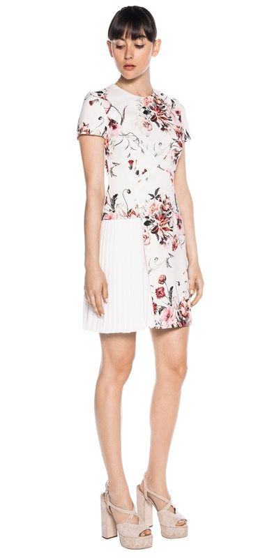Made from spring botanical print, satin back fabric from Europe, this short sleeve dress features angular panelling through the bodice and an asymmetric hem which cuts away to a pleated contrast panel. Fully lined. Fastened with a metal zip back. Made in Australia.