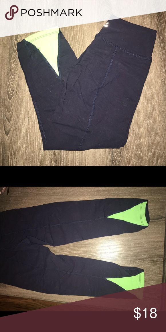 Beyond Yoga Capri Leggings Beyond Yoga Capri Leggings. Hit at mid or low calf. Navy with lime color triangle detail at back of leg. Hem detail down back of thigh for additional shaping. Very soft and stretchy. Beyond Yoga Pants Leggings