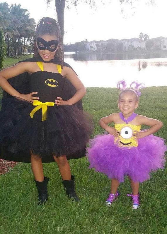 Batman Tutu Dress. Triple layered tutu for extra coverage & poof. Made with yards & yards of quality tulle. Tutus are great for special occasions. This would be great for a birthday party, photos, a Halloween costume, etc.  Robin Tutu Dress https://www.etsy.com/listing/254916409/robin-tutu-dress  Supergirl Tutu Dress http://etsy.me/1MEYwWh  Purple Minion https://www.etsy.com/listing/235705437/minion-dress-perfect-for-birthday  Listing includes dress only