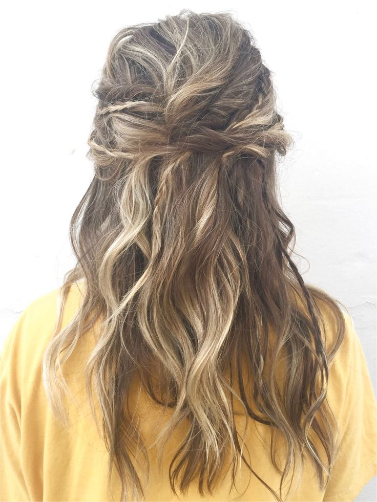 Boho hair prom updo with braids and twists and messy waves half up half down updo loose messy boho chic done at a hair salon in downtown Medford Orego...