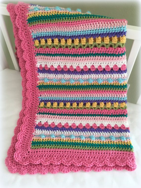 ♥ Pattern name: Confetti Baby Blanket made with bright colors or pastels  ♥ Crochet Baby Blanket Pattern. This is a beautiful way to add color and texture to your babies nursery.   ♥ It would be a welcome and sweet gift for a little newborn!  ♥ The blanket is made with 8 different colors of worsted weight yarn, and uses simple crochet stitches (sc, hdc, dc).   ♥ Sweet and easy pattern by Deborah O'Leary Patterns