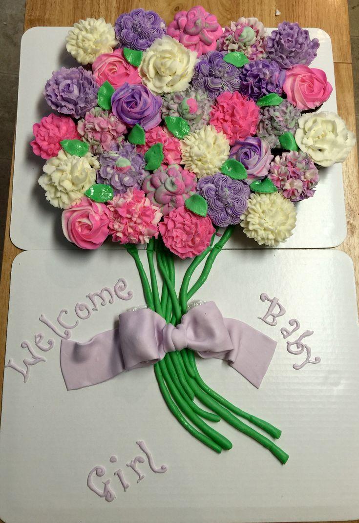 Cupcake pull apart cake flower bouquet cake. Baby shower for little girl.