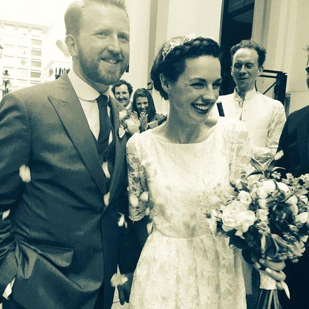Vintage style: Both pictures, one with a brown hue and another in black and white, add a dated affect to the couple's wedding day pictures, perhaps a tribute to the retro acting parts that made their names