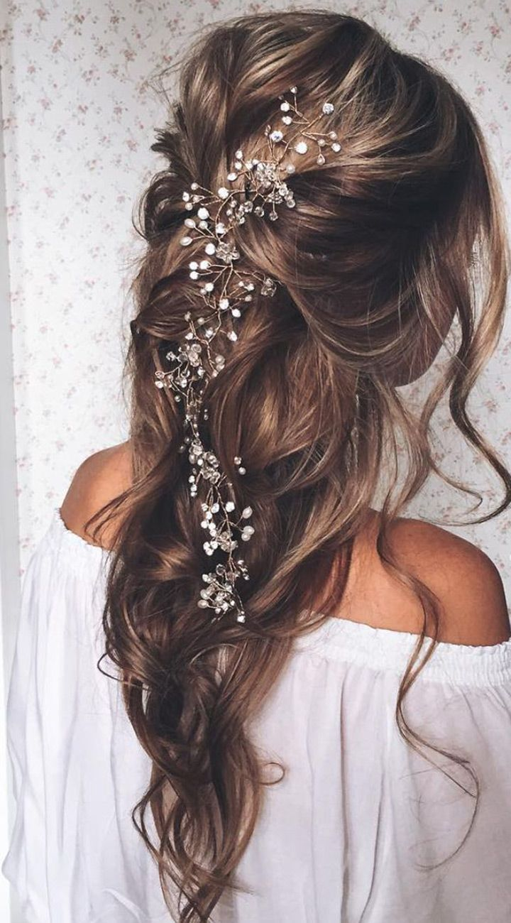 haf up half down wavy wedding hairstyle with hair accessories:
