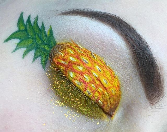 """pineapple eye using: @mehronmakeup white, brown, yellow, orange, green and red paradise paints with @occmakeup """"Neon Yellow"""" glitter under the eye"""