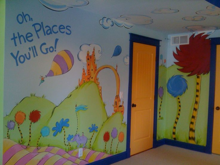 """Dr. Seuss Mural """"Oh, the Places You'll Go!"""" Children's playroom mural. This bonus room turned into a playful space inspired by the book with life-size trufulla trees and story book colored trim and doors."""