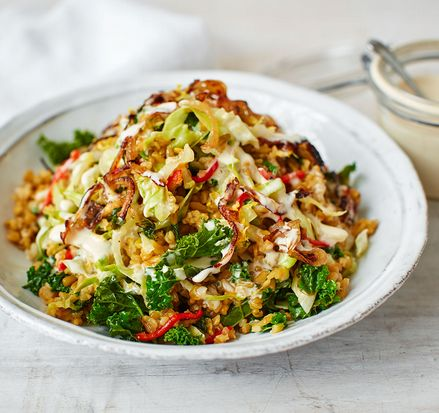 Freekeh has a smoky, nutty flavour which works wonderfully in salads and pilafs. Try it with crispy onions, stir-fried kale and a creamy tahini and lemon dressing in this delicious, seasonal salad.