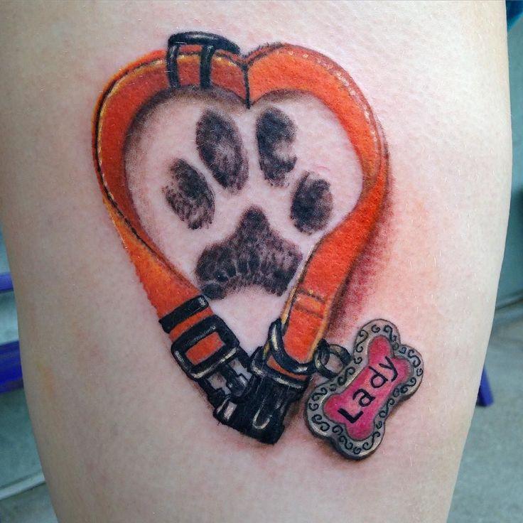 Dog collar tattoo by Diane Lange @moonlighttattoo #dog #dogcollar #pawprint…