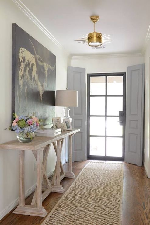 black frame door and large picture with black touches