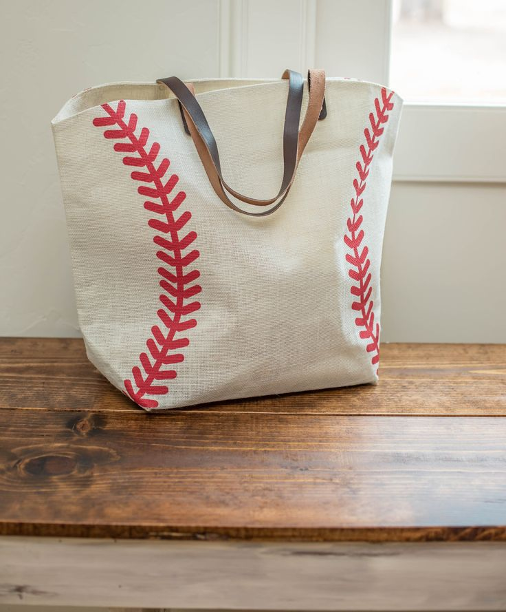 "Our baseball tote bag is approximately 22""W x 8""D x 17""H. Fully lined with zippered pocket inside. Due to the popularity of this item, its current ship time is 10-15 business days."