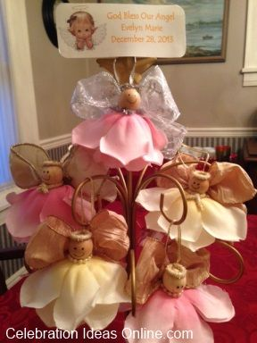 Baptism decoration idea.. centerpiece of angels you can make yourself.. the guests each take one home at the end of the party.  These are perfect for a christening any time of the year.
