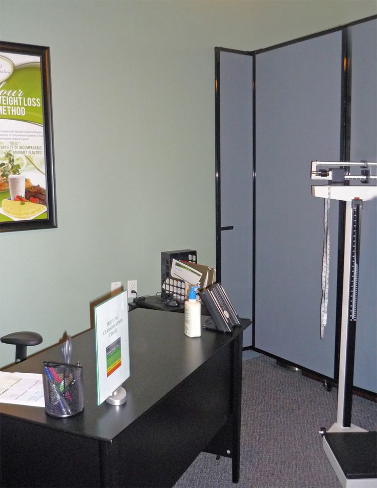 A Private Weight Checking Station Is Created With Versare S Room Divider