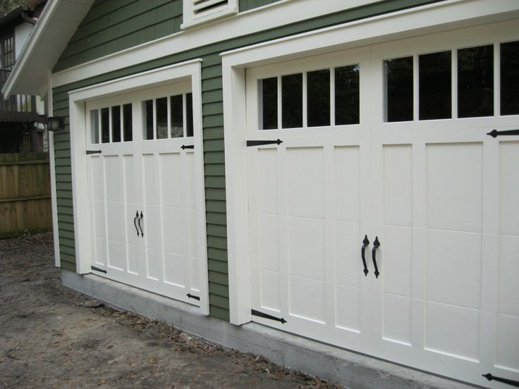 garage doors | Steel overhead garage doors with carriage overlay design that give a ...
