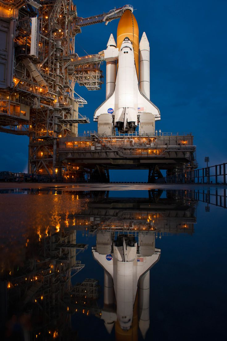 @Astro_Wheels Douglas H. Wheelock: 'Reflection'…Atlantis on the launch pad last night, after the rain. Pad 39A, the same pad that launched the Apollo 11 Saturn V rocket to the moon so many years ago.