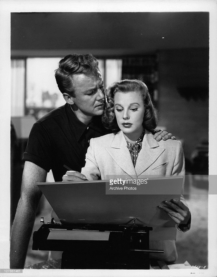 Van Johnson has his arm around June Allyson in a scene from the film 'The Bride Goes Wild', 1948.