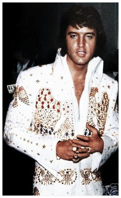 Elvis Presley  His ring means Taking care of business, which he did....for himself and his family and many other people. He had a kind and generous heart.