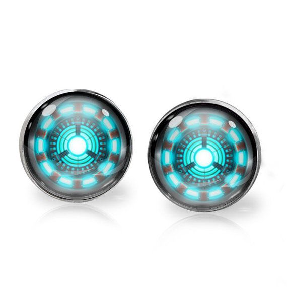 This listing is for ONE pair of Arc Reactor stud earrings inspired by Iron Man. A perfect gift for the fangirl in your life!   These earrings measure 14mm in diameter and utilise glass domes to magnify high quality images set beneath. They are made using high quality surgical steel ear posts for sensitive ears. This listing is part of our Buy THREE get ONE free promotion. Purchase any three pairs of earrings in the promotion and receive one pair of your choice free. Please DO NOT add the…