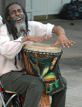 Happy rasta (Rastafarian movement, known by it's colors: gold, green & red, & sometimes a touch of black.)