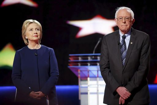 Democratic presidential candidates Hillary Clinton and Bernie Sanders pose together onstage at the start of the U.S. Democratic presidential candidates' debate in Flint, Mich., March 6, 2016. (Photo by Carlos Barria/Reuters)