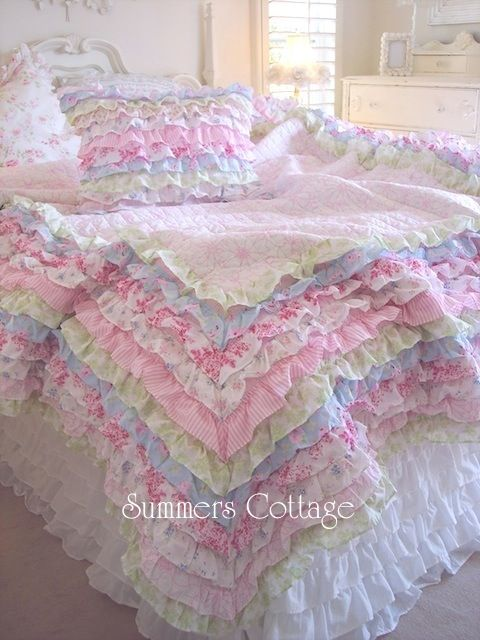 This is my quilt! This stunning Petticoat Ruffles Bedding. It's so warm and wonderful and perfect. Worth every penny. My husband refused to share the blankets with me so I splurged on a girly set of my own.
