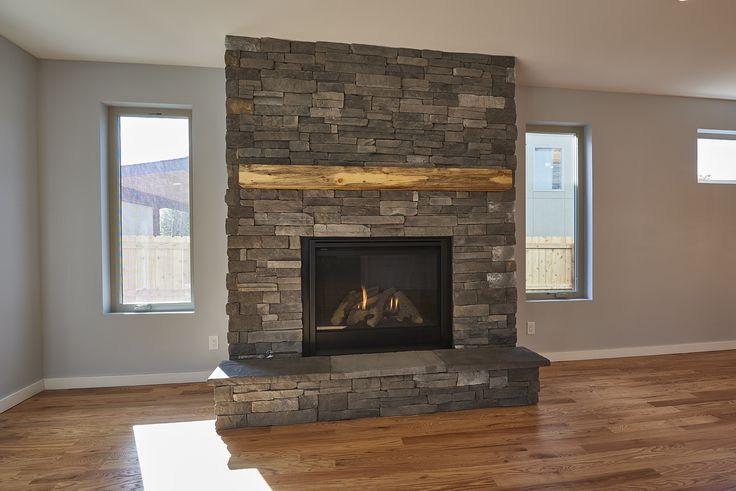 #MountainMeetsModern with this Floating Beetle Kill Mantel & Rustic Pinos Creek Fireplace Stone #MAG #MAGBuilders #MAGDesign