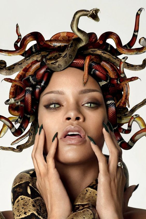 """Titled: """"Rihanna's Illuminati Medusa GQ Cover""""  She is on the cover of a magazine and did a photoshoot for GQ Magazine dressed up as Medusa with snakes in her hair as well as a snake wrapped around her body. This photoshoot is cool and shows how Medusa is still woven into the world today through very modern, famous people."""