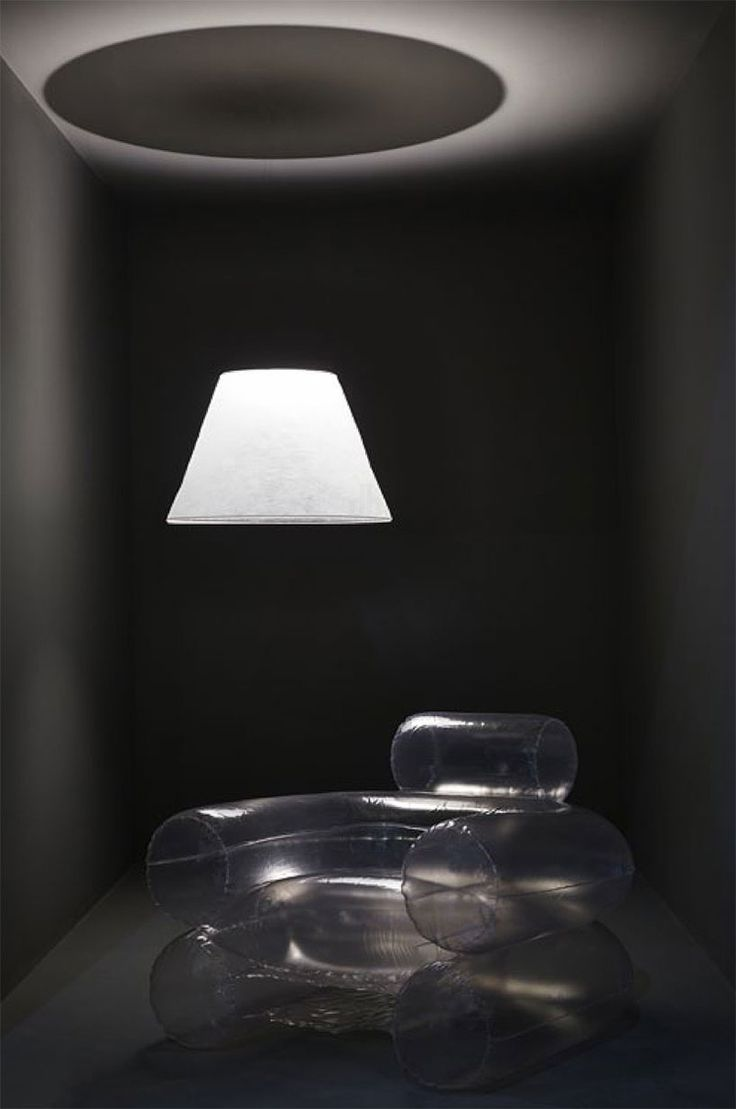 Minimal: gray room, light and blow up chair. (Cool can be inexpensive)
