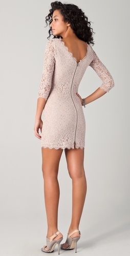 Nude coloured short lace dress with three quarter sleeves and styled back.