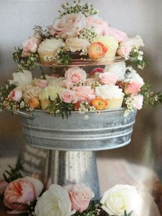 A cupcake tier instead of a big cake is a great dessert option for a summer wedding or baby shower! The flowers are a great addition that could be recreated on a matching chocolate favor.