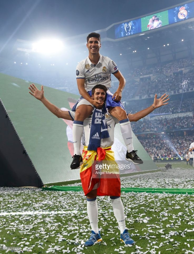 Marco Asensio (Up) and Alvaro Morata of Real Madrid celebrate their UEFA Champions League victory at Estadio Santiago Bernabeu on June 4, 2017 in Madrid, Spain.