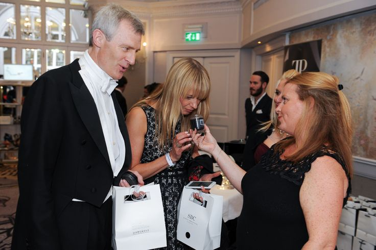 Sara Cox & Jeremy Vine holding onto their valuable SBC goody bag loot!