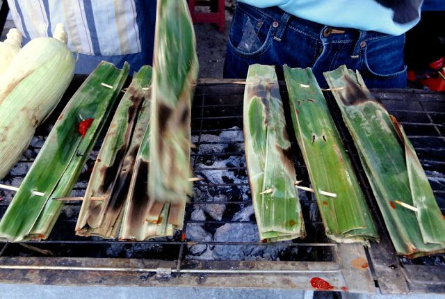 At the Brinchang Night Market in the Cameron Highlands: Otak-otak, fish cake wrapped in banana leaves and grilled on a spit.