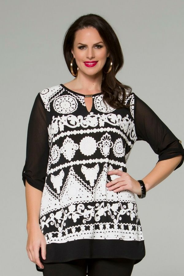 7062 Rubber Art Top - Loose fitting, with a gorgeous neckline, this Rubber Art Top will certainly turn heads. Black, elbow length sleeves, with a tab to roll the sleeves as desired. This top will sit below the hip-line and has a black bordered hem. Perfect for mother of the bride and eveningwear