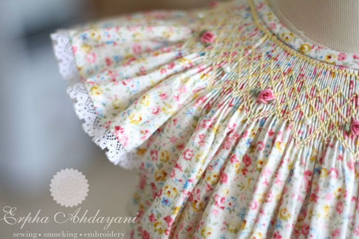 Beautiful rose and trellis smocked angel sleeve dress.