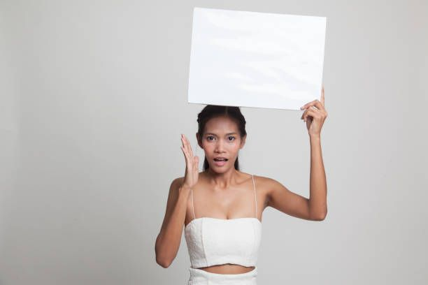 young asian woman surprise with white blank sign