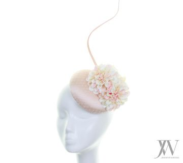 Hat:  Gemma is a light pink silk hat with beautiful flowers.  Bespoke option: This hat can be reproduced in different colours & sizes or using different materials.  As every individual headpiece is handmade by Jennifer, please expect slight variations to the picture.  Sales Enquiries: For bespoke hats or wholesale enquires, please contact our customer service team: Tel: +353 86 352 3692 Email: info@jenniferwrynne.com