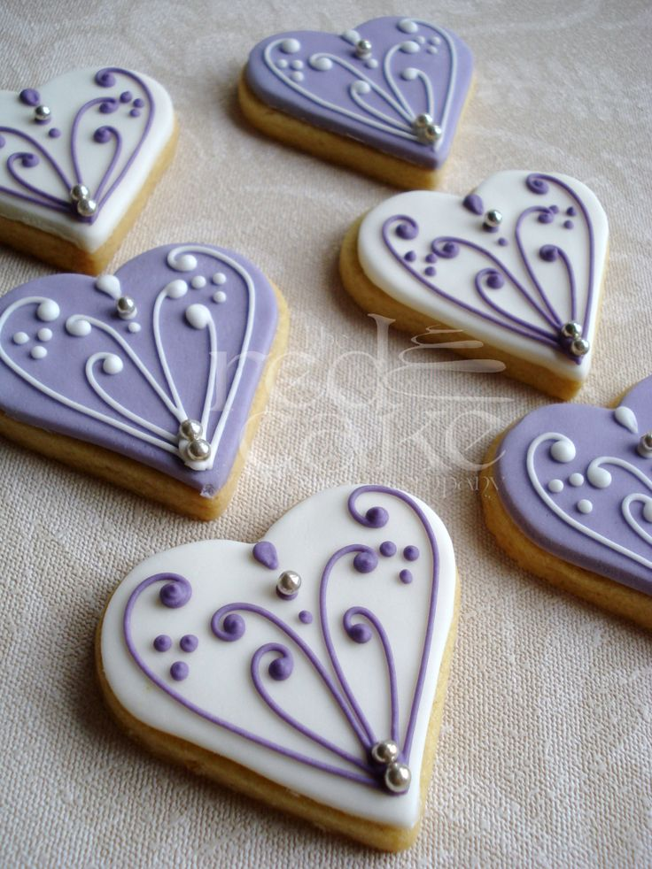 Heart Wedding Cookies~  By The red cake company, purple, white, filigree - For all your Wedding cake decorating supplies, please visit http://www.craftcompany.co.uk/occasions/weddings.html