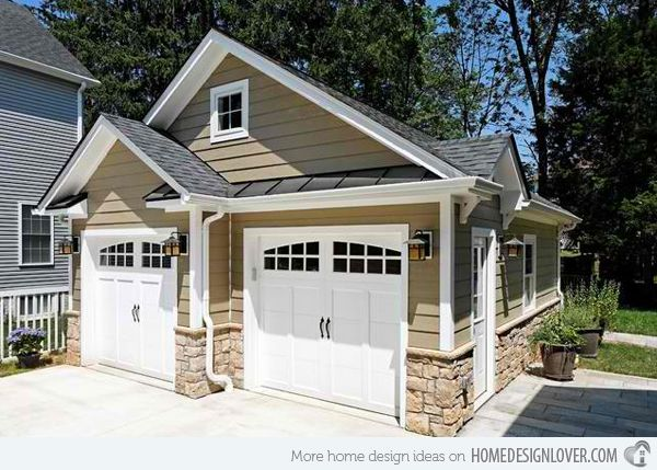 This cute traditional garage has room for two cars and extra storage space.