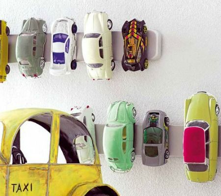Must remember this for when the boy grows up! Magnetic strips to hold cars. From:10 Smart Storage Solutions for Kid's Toys | Disney Baby