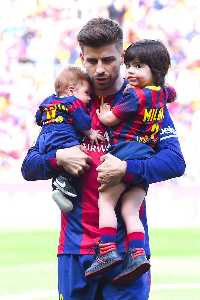 Gerard Pique of FC Barcelona carries his sons Sasha and Milan as he walks onto the pitch prior to the La Liga match between FC Barcelona and Valencia CF at Camp Nou on April 18, 2015 in Barcelona, Catalonia.