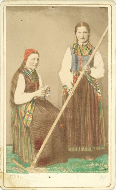 Two girls from Petalax (Osthrobotnia) in traditional clothes. 1876. Finn-Swedish. Photographer: Julia Widgren