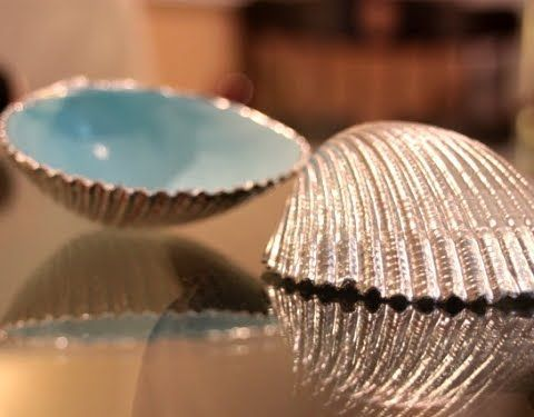 seashell paint makeover; spray paint inside of shells high gloss baby blue and paint outside with gold or silver paint! Stunning!